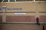 Coventry City 1 Birmingham City 1, 10/03/2012. Ricoh Arena, Championship. A man waiting next to a 'Wall of Fame' dedicated to former home player George Curtis outside the Ricoh Arena, pictured before Coventry City hosted Birmingham City in an Npower Championship fixture. The match ended in a one-all draw, watched by a crowd of 22,240. The Championship was the division below the top level of English football. Photo by Colin McPherson.