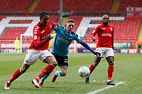 Ashley Hunter of Fleetwood Town tussles with Ezri Konsa of Charlton FC during the Sky Bet League 1 match between Charlton Athletic and Fleetwood Town at The Valley, London, England on 17 March 2018. Photo by Carlton Myrie.