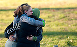 WOODBURY, CT 19 DECEMBER- 121912JS01- A group of mourners comfort one another as they leave the Munson-Lovetere Funeral Home in Woodbury on Wednesday during calling hours for Sandy Hook Principal Dawn Hochsprung who died during a deadly shooting last Friday. .Jim Shannon Republican American
