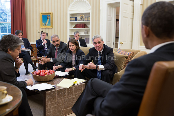 United States President Barack Obama receives an update on the explosions that occurred in Boston, in the Oval Office, April 16, 2013. Seated, from left, are: Homeland Security Secretary Janet Napolitano; Tony Blinken, Deputy National Security Advisor; Jake Sullivan, National Security Advisor to the Vice President; Attorney General Eric Holder; Lisa Monaco, Assistant to the President for Homeland Security and Counterterrorism; Chief of Staff Denis McDonough; and FBI Director Robert Mueller. .Mandatory Credit: Pete Souza - White House via CNP <br />