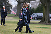 United States President Donald J. Trump and first lady Melania Trump walk on the South Lawn of the White House before boarding Marine One on January 13, 2020 in Washington, DC. President Trump and first lady will attend the College Football Playoff National Championship in New Orleans, Louisiana.<br /> Credit: Oliver Contreras / Pool via CNP