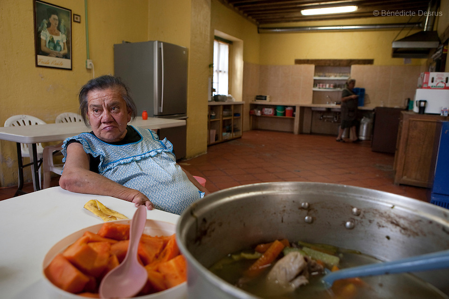 Canela, a resident of Casa Xochiquetzal, seats in the kitchen at the shelter in Mexico City, Mexico on March 4, 2008. Casa Xochiquetzal is a shelter for elderly sex workers in Mexico City. It gives the women refuge, food, health services, a space to learn about their human rights and courses to help them rediscover their self-confidence and deal with traumatic aspects of their lives. Casa Xochiquetzal provides a space to age with dignity for a group of vulnerable women who are often invisible to society at large. It is the only such shelter existing in Latin America. Photo by Bénédicte Desrus