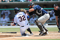 Mobile BayBears Josh Ford #30 goes for the punch out of a hard sliding Blake Lalli during a game against the Tennessee Smokies at Smokies Park in Kodak,  Tennessee;  May 22, 2011.  The Smokies won the game 4-2.  Photo By Tony Farlow/Four Seam Images