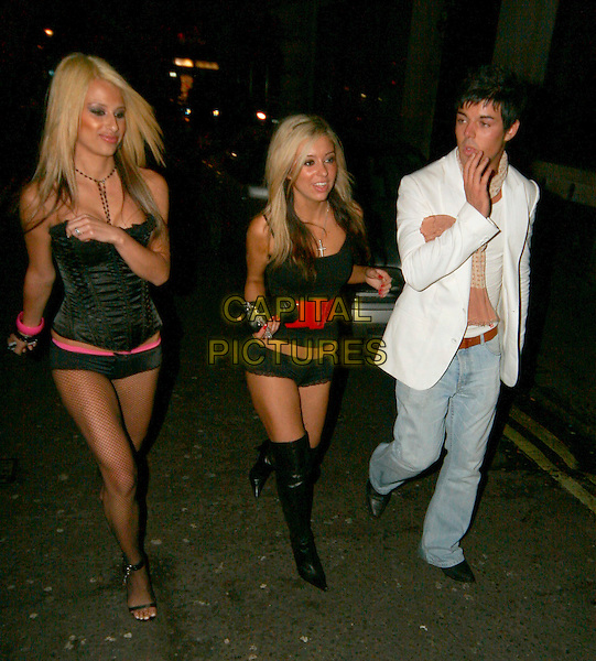 ANTHONY HUTTON & GIRLS.Leaving at Chinawhite, London, UK..February 16th, 2006.Ref: SW.full length white suit jacket jeans denim Big Brother black hot pants boots looks drunk.www.capitalpictures.com.sales@capitalpictures.com.©Capital Pictures.
