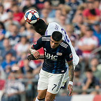 FOXBOROUGH, MA - JULY 27: Lamine Sane #22 and Gustavo Bao #7 battle for head ball during a game between Orlando City SC and New England Revolution at Gillette Stadium on July 27, 2019 in Foxborough, Massachusetts.