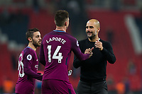Manchester City manager Josep Guardiola celebrates with Manchester City's Aymeric Laporte <br /> <br /> Photographer Craig Mercer/CameraSport<br /> <br /> The Premier League - Tottenham Hotspur v Manchester City - Saturday 14th April 2018 - Wembley Stadium - London<br /> <br /> World Copyright &copy; 2018 CameraSport. All rights reserved. 43 Linden Ave. Countesthorpe. Leicester. England. LE8 5PG - Tel: +44 (0) 116 277 4147 - admin@camerasport.com - www.camerasport.com
