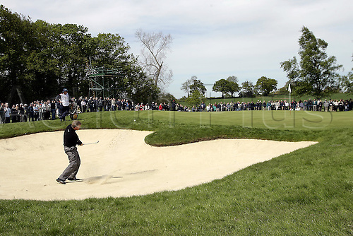 13 May 2005: Scottish golfer Colin Montgomerie plays from a green-side bunker during the second round of the The Daily Telegraph Dunlop Masters played at the Forest of Arden, Warwickshire. Photo: Neil Tingle/Actionplus..050513 golf golfer player sand-trap sand