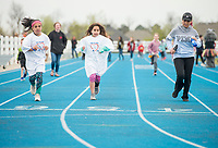 NWA Democrat-Gazette/BEN GOFF @NWABENGOFF<br /> Participants run laps Saturday, April 21, 2018, during the Northwest Arkansas Kiwanis Clubs Fun Walk benefiting Arkansas Children's Northwest at the track at Springdale Har-Ber High. Thirteen Kiwanis clubs from Benton, Washington and Madison counties joined forces for the annual fundraiser.