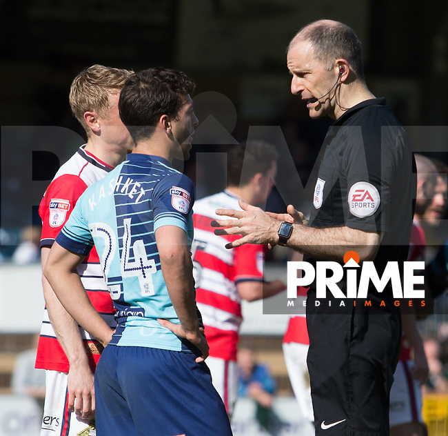 Referee Graham Horwood has words with Scott Kashket of Wycombe Wanderers and Craig Alcock of Doncaster Rovers during the Sky Bet League 2 match between Wycombe Wanderers and Doncaster Rovers at Adams Park, High Wycombe, England on 22 April 2017. Photo by James Williamson / PRiME Media Images.