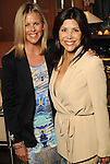 Elizabeth Petersen and Ericka Bagwell at a cocktail party at the home of Becca Cason Thrash featuring a trunk show from Christos Garkinos, owner of the L.A. boutique Decadestwo Wednesday April 21,2010.. (Dave Rossman Photo)