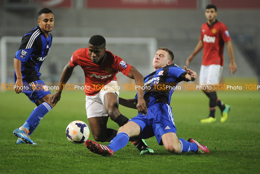 Bryn Morris of Middlesbrough makes a challenge on Wilfried Zaha of Manchester United - Manchester United Under-21 vs Middlesbrough Under-21 - Barclays Under-21 Premier League Football at Salford City Stadium, Manchester - 20/01/14 - MANDATORY CREDIT: Greig Bertram/TGSPHOTO - Self billing applies where appropriate - 0845 094 6026 - contact@tgsphoto.co.uk - NO UNPAID USE