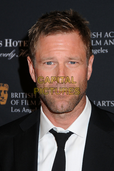 AARON ECKHART .17th Annual BAFTA Los Angeles Awards Season Tea Party held at the Four Seasons Hotel, Beverly Hills, California, USA, 15th January 2011..portrait headshot white shirt black tie stubble facial hair .CAP/ADM/BP.©Byron Purvis/AdMedia/Capital Pictures.