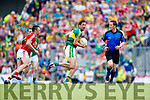 Anthony Maher Kerry in action against Paul Kerrigan                                                                   Cork in the Munster Senior Football Final at Fitzgerald Stadium on Sunday.