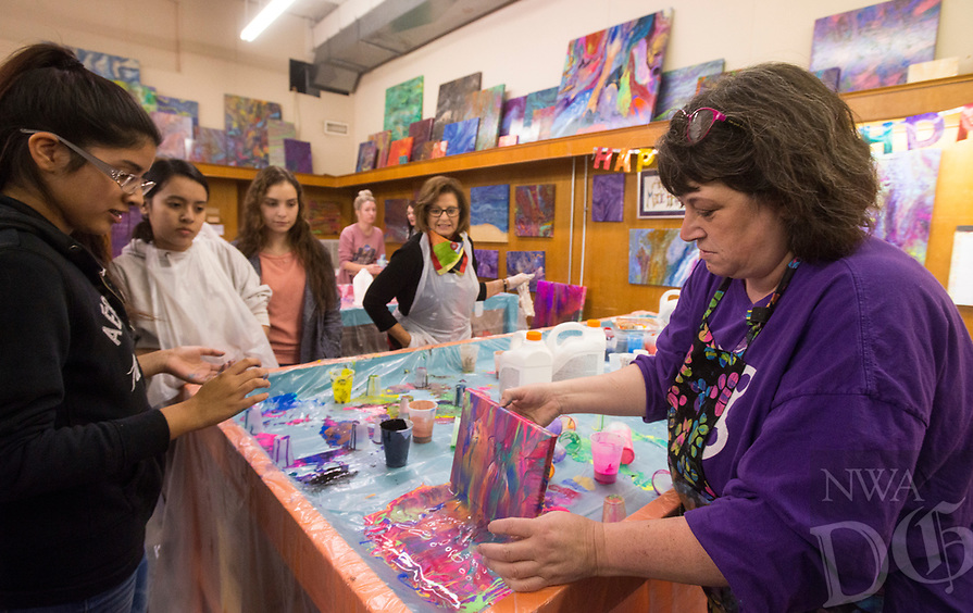 NWA Democrat-Gazette/BEN GOFF @NWABENGOFF<br /> Marie Haley (right) of Art &amp; Soul Studios NWA teaches a fluid art class for the Rogers Heritage High School chapter of Family, Career and Community Leaders of America Thursday, Nov. 8, 2018, at Rogers Experimental House during the 'Light Up the Night!' one year anniversary Art on the Bricks art walk in downtown Rogers. More than 25 artists and musicians opened pop-up galleries selling their artwork at downtown shops and restaurants. Go Downtown Rogers hosts the walks on the second Thursday of each month.