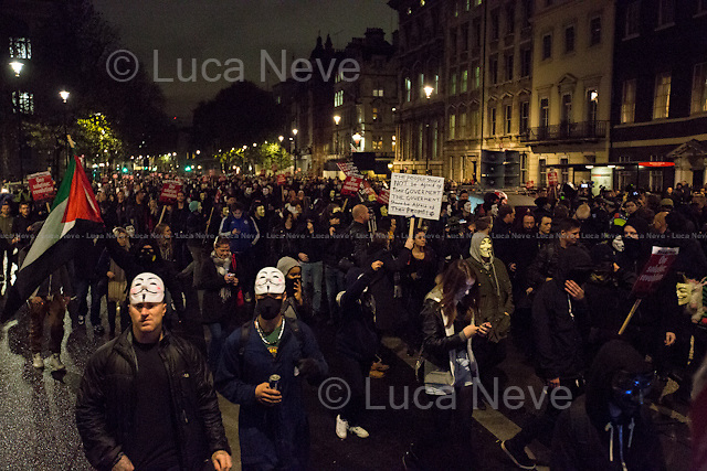 Whitehall.<br /> <br /> London, 05/11/2015. Thousands of protesters gathered this evening in central London to take part in a demonstration called the &quot;Million Mask March&quot;, which is organised annually by Anonymous, and held globally in more than 400 cities planned to coincide with Guy Fawkes Night (The Gunpowder Plot of 1605). The aim of the demo was to highlight social injustice and Government corruption across the globe, but also to protect the environment, freedom of the internet, oppose mass surveillance and austerity. The rally started in Trafalgar Square, and then the protesters marched on Whitehall, gathering in Parliament Square. Around 7:00pm, a large group marched towards Great George street where clashes erupted with police officers in full riot gears, supported by police dogs and mounted police. Then, the demonstration carried on towards Victoria (where a police car was set on fire), Buckingham Palace and The Mall, to end in the Trafalgar Square area, where the police contained the last activists in &quot;kettles&quot; until around 11:30pm.<br /> <br /> For more information please click here: http://on.fb.me/1mcn5Z7