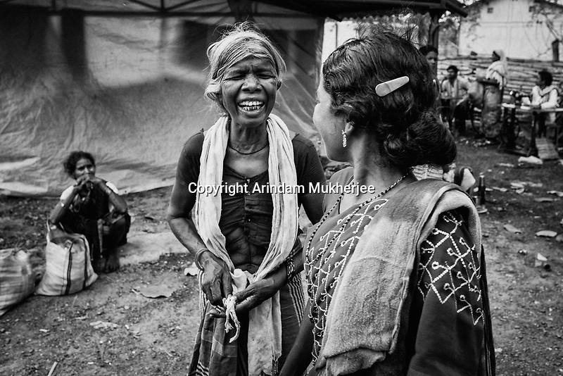 An old tribal lady smiles during a conversation. Weekly markets are the sites for social interaction. Sukma, Chattisgarh, India. Arindam Mukherjee