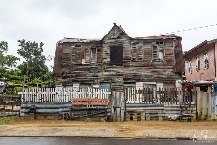 An old wooden house in the Freedman's DIstrict in Paramaribo, Suriname.  This district of the city developed as a neighborhood of freed slaves after the abolishment of slavery in Suriname in 1863.