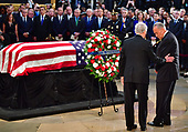 Senate Majority Leader Mitch McConnell, R-KY, and Senate Minority Leader Charles Schumer, D-NY, lay a wreath at the casket of Senator John McCain during his memorial service at the Capitol Rotunda where he will lie in state at the U.S. Capitol, in Washington, DC on Friday, August 31, 2018. McCain, an Arizona Republican, presidential candidate, and war hero, died August 25th at the age of 81. He is the 31st person to lie in state at the Capitol in 166 years. Photo Ken Cedeno/UPI