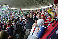 United States Men's National team fans cheer at Azteca stadium. The United States Men's National Team played Mexico in a CONCACAF World Cup Qualifier match at Azteca Stadium in, Mexico City, Mexico on Wednesday, August 12, 2009.