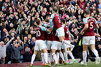 Burnley's Chris Wood is mobbed by team-mates as he celebrates scoring the opening goal <br /> <br /> Photographer Rich Linley/CameraSport<br /> <br /> The Premier League - Saturday 13th April 2019 - Burnley v Cardiff City - Turf Moor - Burnley<br /> <br /> World Copyright © 2019 CameraSport. All rights reserved. 43 Linden Ave. Countesthorpe. Leicester. England. LE8 5PG - Tel: +44 (0) 116 277 4147 - admin@camerasport.com - www.camerasport.com