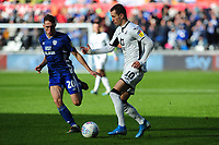 Gavin Whyte of Cardiff City vies for possession with Bersant Celina of Swansea City during the Sky Bet Championship match between Swansea City and Cardiff City at the Liberty Stadium in Swansea, Wales, UK. Sunday 27 October 2019