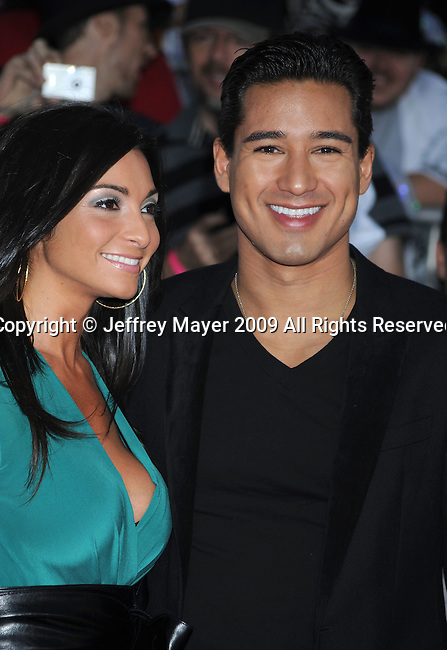 """LOS ANGELES, CA. - October 27: Courtney Mazza and Actor Mario Lopez  arrive at the Los Angeles Premiere of """"This Is It"""" held at Nokia Theatre L.A. Live on October 27, 2009 in Los Angeles, California."""