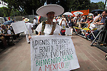 A Mexican demostrator holds up a banner during the meeting to support Bolivian president Evo Morales in Coyoacan, a Mexico City's dicstrict, Februray 21, 2010. Thousands of people are expected to gather around Evo Morales. Photo by Heriberto Rodriguez