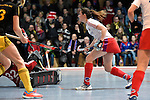 Mannheim, Germany, January 24: During the 1. Bundesliga Damen Hallensaison 2014/15 quarter-final hockey match between Mannheimer HC (white) and Harvestehuder THC (black) on January 24, 2015 at Irma-Roechling-Halle in Mannheim, Germany. Final score 2-3 (2-2). (Photo by Dirk Markgraf / www.265-images.com) *** Local caption *** Maxi Pohl #6 of Mannheimer HC