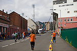 Fans making their way up Tannadice Street, Dundee towards Tannadice Park, home of Dundee United on the day they played host to Dunfermline Athletic in a Scottish Premier League match. The visitors won the game by one goal to nil, watched by a crowd of 6,527. Dundee United's stadium was situated on the same street as their city rival Dundee, whose Dens Park ground was visible in the background.