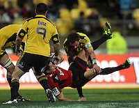 Aaron Cruden tackles Dan Carter. Super 15 rugby match - Crusaders v Hurricanes at Westpac Stadium, Wellington, New Zealand on Saturday, 18 June 2011. Photo: Dave Lintott / lintottphoto.co.nz