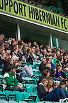 Home fans in the Famous Five stand watching the second-half action at Easter Road stadium during the Scottish Championship match between Hibernian and visitors Alloa Athletic. The home team won the game by 3-0, watched by a crowd of 7,774. It was the Edinburgh club's second season in the second tier of Scottish football following their relegation from the Premiership in 2013-14.