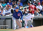 Diamondbacks&rsquo; David Peralta beats the throw to first against Cub&rsquo;s Anthony Rizzo during a spring training game in Scottsdale, Ariz., on Thursday, March 23, 2017.<br />