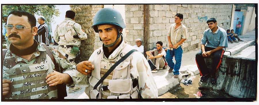 Iraqi soldiers attached to 4-14 Cav 172nd Stryker Battalion sweep through the streets of Shula - a predominantly Shiite area of northwestern Baghdad - on Sat. August 19, 2006.  The 172nd was extended at the last moment - with portions of the brigade already back in the States - when they were called upon to bolster security forces in Baghdad seeking to get a handle on a massive wave of sectarian killings in the Iraqi capital. This effort - labelled Operation Together Forward - has thus far seen US and Iraqi forces conduct cordon and searches of four of the most violence-plagued districts in the capital.