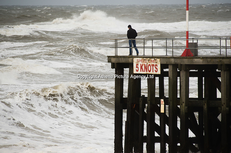 Aberystwyth Wales UK, Wednesday 02 march 2016 <br /> UK weather: A man looks on as huge waves crash over the harbour wall and lighthouse as gale force winds again hit Aberystwyth in West Wales . <br /> Gusts of up to 70mph are predicted  to affect western coastal areas, , making for difficult driving conditions and bringing the risk of some structural damage .<br /> The latest storm of the winter has been officially named as Storm Jake by the Irish weather service, Met Eireann,