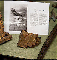 BNPS.co.uk (01202 558833)<br /> Pic: PhilYeomans/BNPS<br /> <br /> Ray Ives Locker<br /> <br /> Ray retrieved a lump of the infamous Torrey Canyon.<br /> <br /> Old man of the sea Ray Ives has opened his very own Davy Jones' locker of hundreds of nautical treasures he has salvaged from the seabed.<br /> <br /> Ray(77) has spent 40 years amassing a huge trove of historical artefacts that he has found during thousands of deep sea dives off the British coast.<br /> <br /> Ray's watery Aladdins cave includes canon balls, muskets, swords and even the bell from an ocean liner sunk by a German U-boat in the First World War.<br /> <br /> For years Ray had stuffed his collection into a tiny shed in the back garden of his home in Plymouth, Devon.<br /> <br /> But now the fascinating archive has now gone on display to the public in a ramshackle museum made from shipping containers.