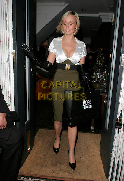 CHANELLE HAYES.At the Adee Phelan Hairdressing Salon Launch, Covent Garden, London, England, November 27th 2007..full length posh spice look-a-like green khaki military style pencil skirt white shirt blouse top black elbow length gloves shoes belt goody bag .CAP/AH.©Adam Houghton/Capital Pictures.