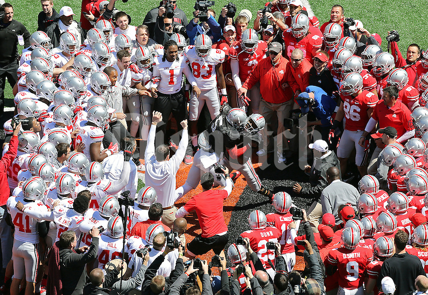 Ohio State Buckeyes Scarlet Team quarterback Braxton Miller (5) and Ohio State Buckeyes Gray Team quarterback Kenny Guiton (13) battle each other during the circle drill before Ohio State spring game at Paul Brown Stadium in Cincinnati, Ohio on April 13, 2013.  (Dispatch photo by Kyle Robertson)