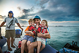 GALAPAGOS ISLANDS, ECUADOR, Father with his son and daughter travel in a zodiac as they leave Fernandina Island