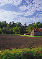 A small barn sits aside a freshed tilled field in Amish farm country, Fillmore County, Minnesota