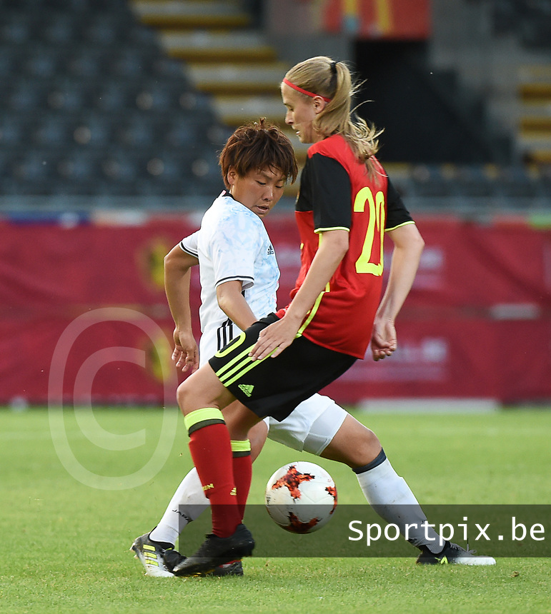 20170613 - LEUVEN ,  BELGIUM : Belgian Julie Biesmans (R) and Japanese Hikari Takagi (L) pictured during the female soccer game between the Belgian Red Flames and Japan , a friendly game before the European Championship in The Netherlands 2017  , Tuesday 13 th Juin 2017 at Stadion Den Dreef  in Leuven , Belgium. PHOTO SPORTPIX.BE | DIRK VUYLSTEKE