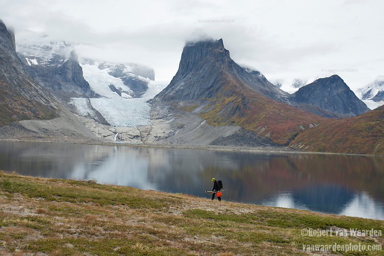 A scientist walks along the shore of Greenland's Tasermiut Fjord.The scientist is part of the Cape Farewell Youth Expedition that was organized by the British Council of Canada.