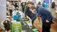 A visitor, right, and a Cashtivity employee at the TechDay New York event on Thursday, April 23, 2015. Thousands attended to seek jobs with the startups and to network with their peers. TechDay bills itself as the world's largest startup event with over 300 exhibitors. (© Richard B. Levine)
