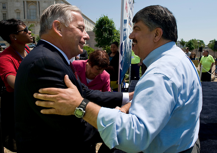 "Rep. Gene Green, D-Texas, talks with AFL-CIO President Richard Trumka during the ""All Union Healthcare Thank You"" rally at the House East Fountain behind Longworth, on Thursday, May 6, 2010."