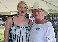 NWA Democrat-Gazette/CARIN SCHOPPMEYER Alyson Jacobs (left) and Henrietta Habern help support Horses for Healing.