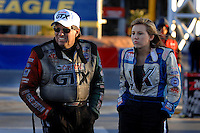 Jan 21, 2007; Las Vegas, NV, USA; NHRA Funny Car driver John Force with daughter Courtney Force during preseason testing at The Strip at Las Vegas Motor Speedway in Las Vegas, NV. Mandatory Credit: Mark J. Rebilas