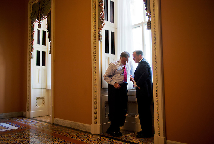 UNITED STATES - MAY 14: Sen. Richard Burr, R-N.C., left, talks with Tom Hawkins, from the office of Senate Minority Leader Mitch McConnell, R-Ky., off the Senate floor in the Capitol. (Photo By Tom Williams/CQ Roll Call)