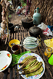 PHILIPPINES, Palawan, Barangay region, dinner and fresh ingredients are being prepared and cooked over an open fire in Kalakwasan Village