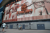 9th May 2020, Emirates  Stadium, London, England; Male cyclist exercising outside the Emirates Stadium  during the Covid-19 lockdown
