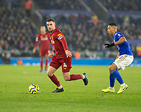 26th December 2019; King Power Stadium, Leicester, Midlands, England; English Premier League Football, Leicester City versus Liverpool; Jordan Henderson of Liverpool with the ball at his feet looking for a pass watched by Youri Tielemans of Leicester City  - Strictly Editorial Use Only. No use with unauthorized audio, video, data, fixture lists, club/league logos or 'live' services. Online in-match use limited to 120 images, no video emulation. No use in betting, games or single club/league/player publications