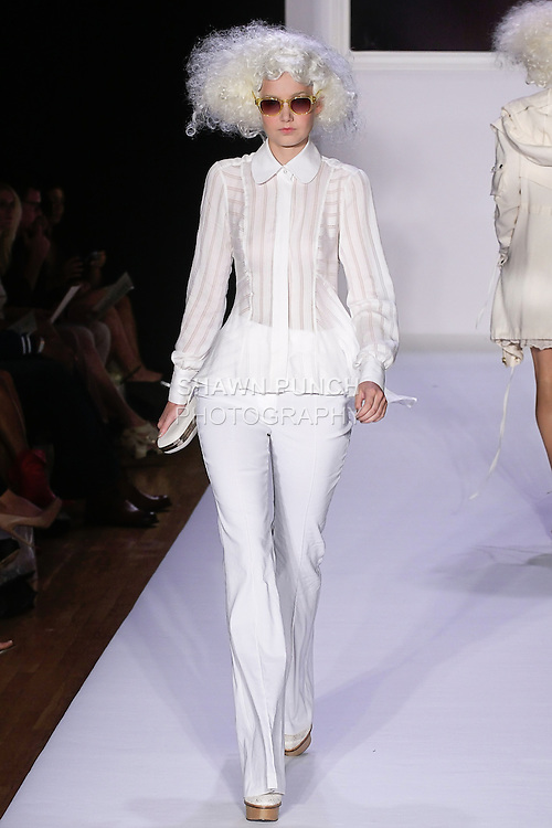 Caris walks runway in a pristine white shadow stripe silk georgette peplum with matching flare pant,.Natural crochet minaudiere, and.Sarah natural lace oxford, for the bebe BLACK Spring 2012 collection fashon show, during Elle Stlye 360 Spring 2012 Fashion Week.